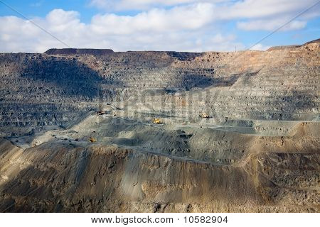 Close-up golden Open Pit  Mine