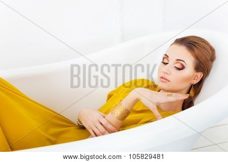 Young Beautiful Girl With Make Up Wearing Long Yellow Dress