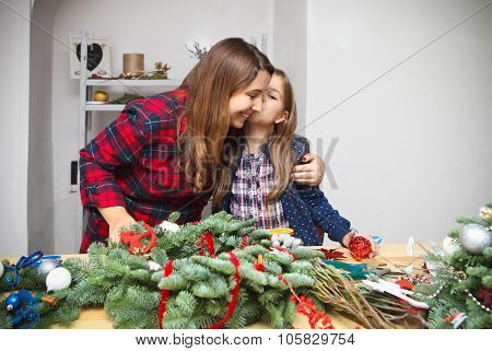 Mother Making An Advent Wreath With Daughter