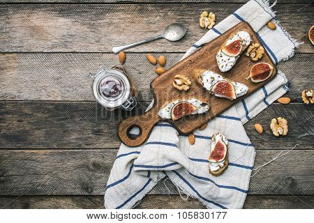 Bruschetta Snacks With Nuts Jam And Figs On Napkin