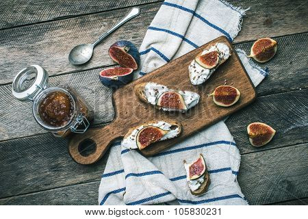 Cut Figs And Bruschetta Snakcs With Jam And On Napkin