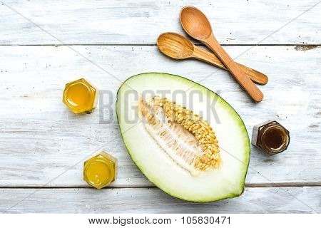 Melon Spoon And Honey On White Board