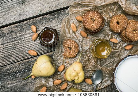 Pears Nuts Cookies And Milk On Rustic Wood