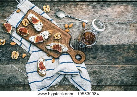 Snacks With Cheese Jam And Figs On Wood