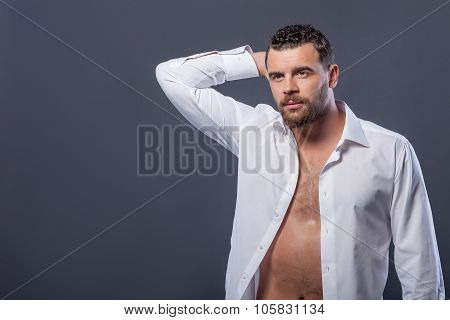 Attractive strong guy is expressing his desire