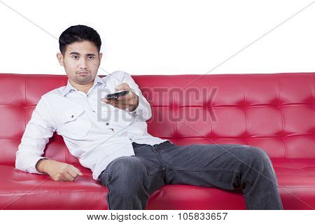 Man With Bored Expression Watching Tv