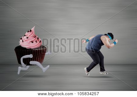 Overweight Person Chased By Cupcake