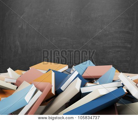 A Heap Of Different Books With Colorful Covers Which Are Laying On The Floor. Black Chalk Board On T