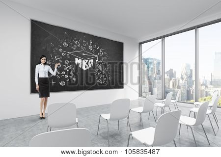 A Brunette Makes A Presentation In A Classroom In A Modern University Or Fancy Office. White Chairs,