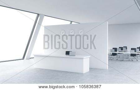 Reception Area With Clocks And Workplaces In A Bright Modern Open Space Loft Office. White Tables An