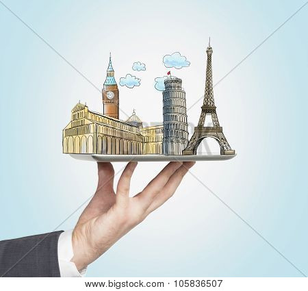 A Man's Hand Holds A Tablet With Sketches Of The Most Famous Places In Italy, Great Britain And Fran