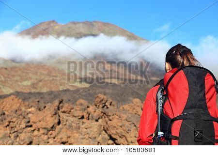 Woman Hiking Looking At Mountain