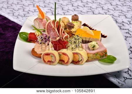 Antipasto And Catering Platter With Different Appetizers(fruits, Vegetables, Meats, Cheeses)on White
