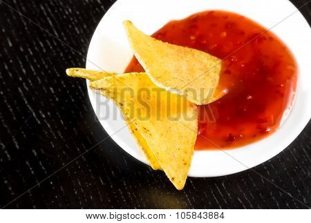 Crisp Corn Nachos With Spicy Hot Tomato Sauce As A Snack Or Appetizer In A White Disc