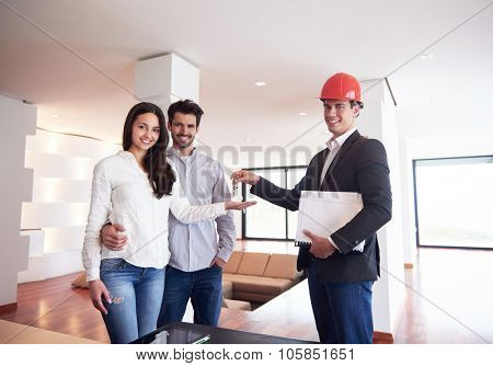 happy young family,  couple buying new home with real estate agent, people group interior