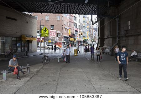 People Under Beginning Of Manhattan Bridge In Chinatown Manhattan New York City