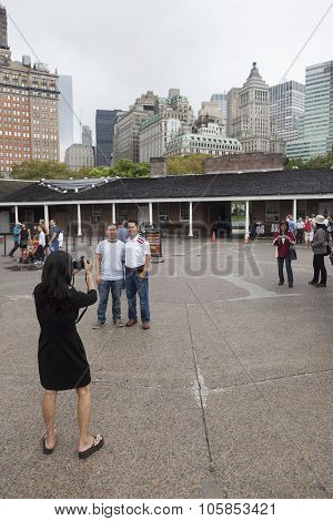 Tourist Takes Pictures Of People And Downtown Manhattan In Castle Clinton