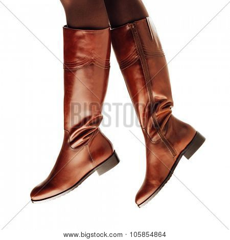 woman legs wearing brown leather high boots, isolated on white