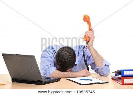 Exhausted Businessman Holding A Telephone Tube