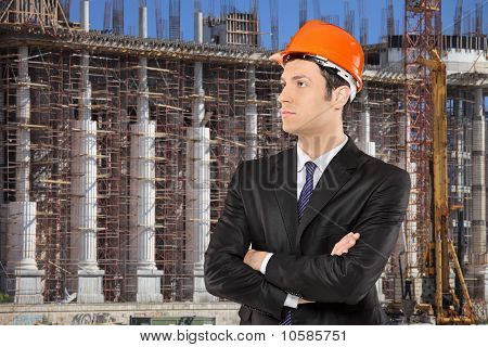 Foreman Standing With A Construction Site In The Background