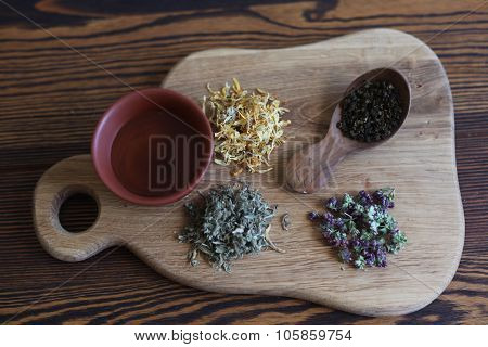 Herbs for tea on the wooden board