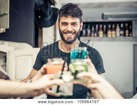 Smiling Bartender With Cocktails Toast