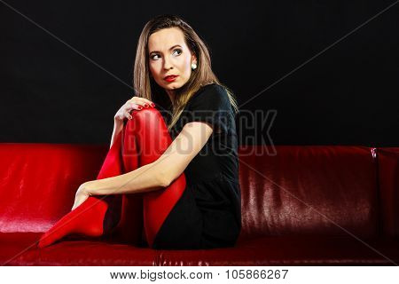 Sad Woman Sitting On Red Couch