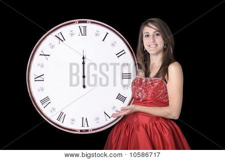 Young Woman In Evening Dress With Midnight Clock