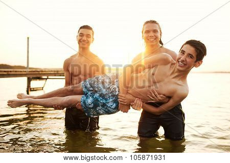 Multi Ethnic Teenage Friends Having Fun At The Lake
