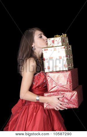 Young Woman Kissing Christmas Presents