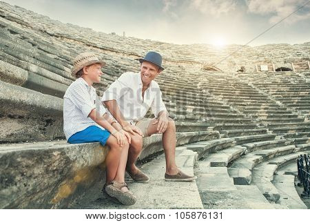 Father And Son Spent Time Together On Antique Ruins Amphitheater