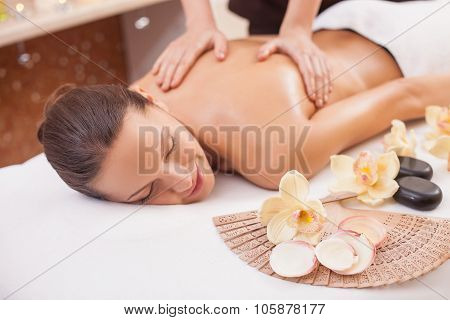 Cute female model is resting at health resort