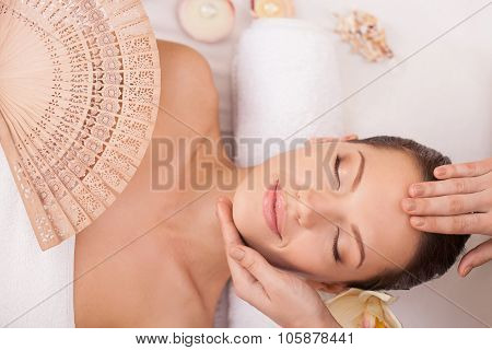 Cheerful healthy girl is resting at beauty salon