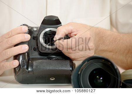 photographer cleaning sensor of his camera