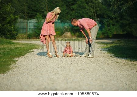 cute little boy with his parents outdoors