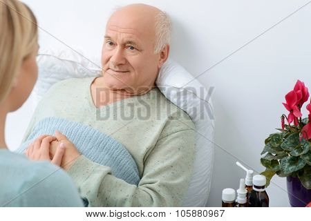Young relative takes care of her sick grandfather.