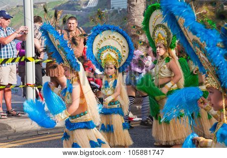 Puerto De La Cruz, Spain - February 16: Colorfully Dressed Participants Take Part In Main Carnival P