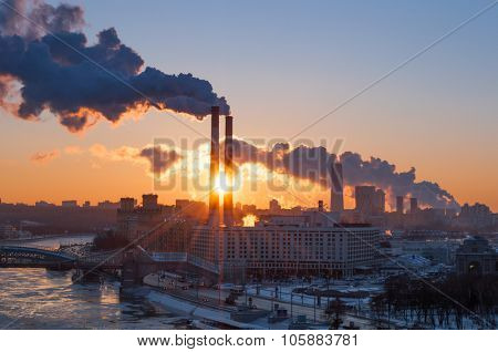 Industrial landscape with thermal power plant during sunrise in Moscow