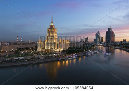 Stalin skyscraper - Ukraine Hotel near Moskva river during sunset in Moscow