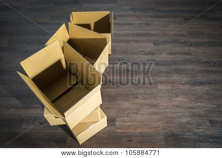 Pile Of Cardboard Boxes On Parquet  Home Relocation