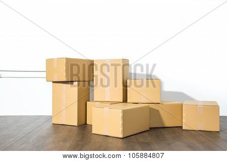 Pile Of Cardboard Boxes On White Background With Box Shadow