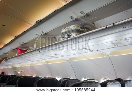 Cabin Baggage Overhead On The Airplane