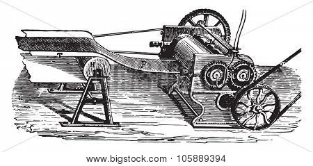 Cylinder for the manufacture of laminated rubber sheets, vintage engraved illustration. Industrial encyclopedia E.-O. Lami - 1875.