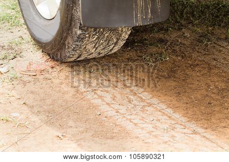 Four Wheel Drive Tire With Tracks On Dry Dirt Road