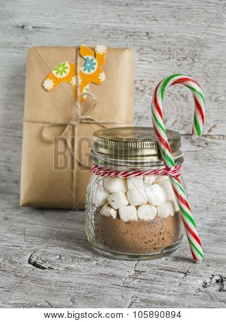 Homemade Christmas Gift - Ingredients For Making Hot Chocolate With Marshmallows In A Glass Jar On A
