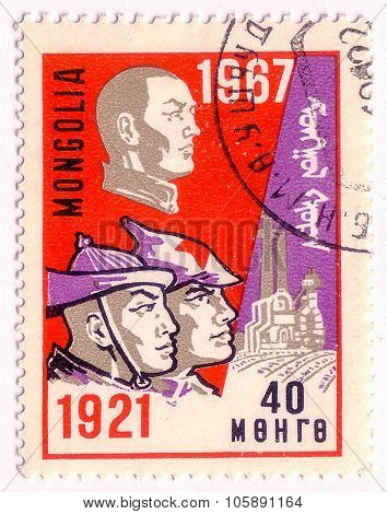Mongolia - Circa 1967: A Stamp Printed In Mongolia Shows Portraits Of Three Man Dedicated 50Th Anniv