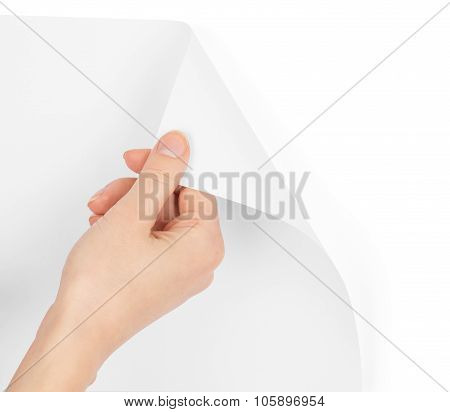 Humans hand turning blank page