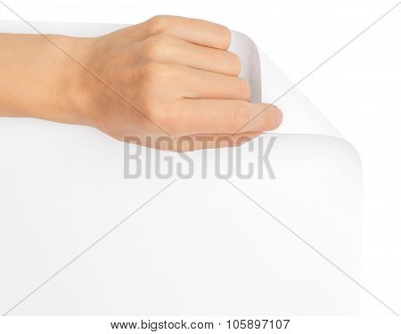Womans hand turning blank page corner