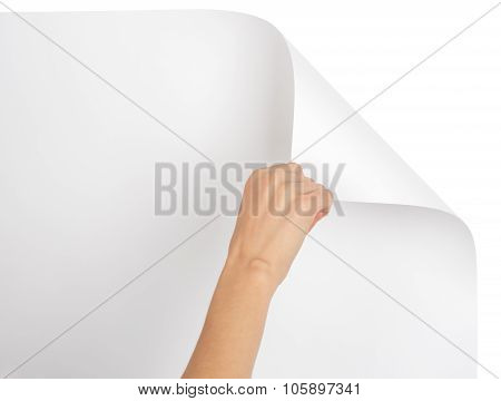 Hand turning upper empty page corner