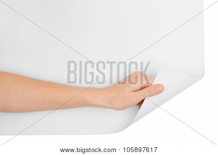Womans hand turning bottom blank page corner